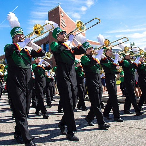 Trombone section in the UAB Band marching during the Homecoming parade.