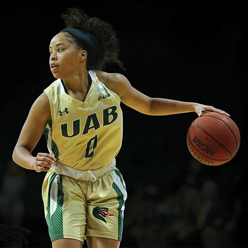 UAB basketball player scoring during game against Western Kentucky.
