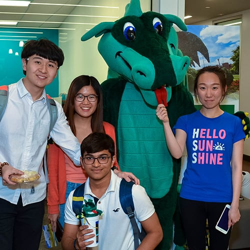Group of students posing with Blaze.