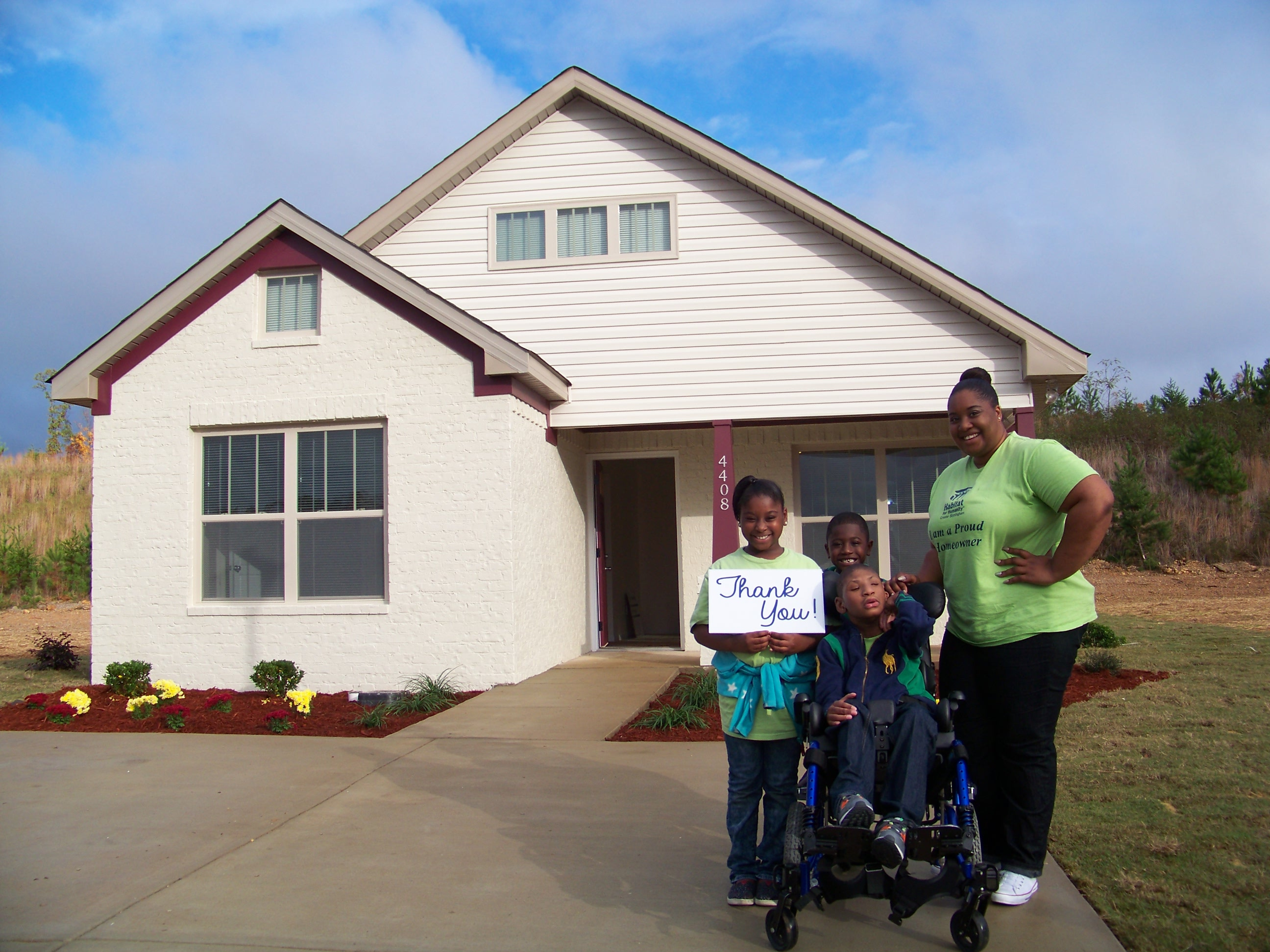 Dixon family outside of 2015 UAB Habitat House