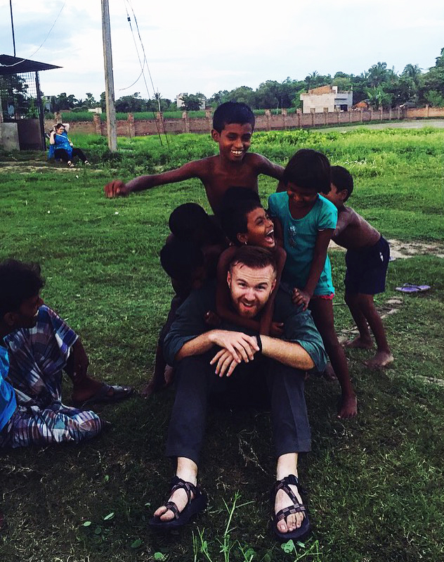 Kyle Baker with kids in India