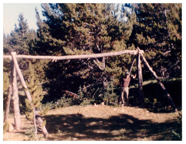 Mumford building (with others) an experimental Athapaskan winter lodge during UBC Anthropology Dept. 1985 archaeology field school on Potato Mountain, Chilcotin region, BC, Canada (Photo: Philip).