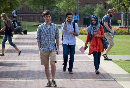 Students walking on the UAB Campus Green.