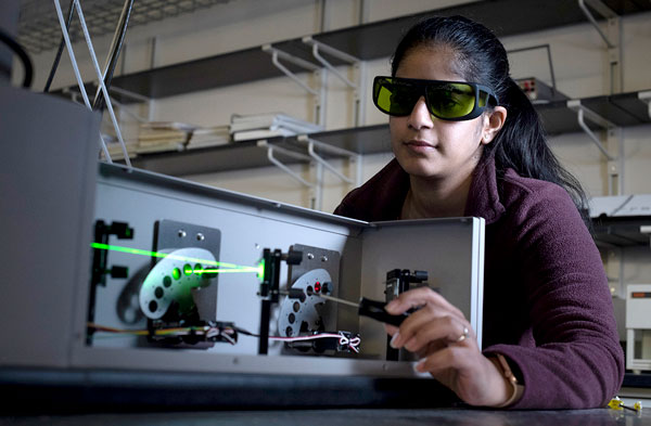 Student using lasers in the lab.