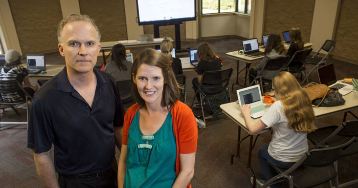 Dr. John Johnstone and alumna Lindsay Hannon lead a Girls Who Code event.