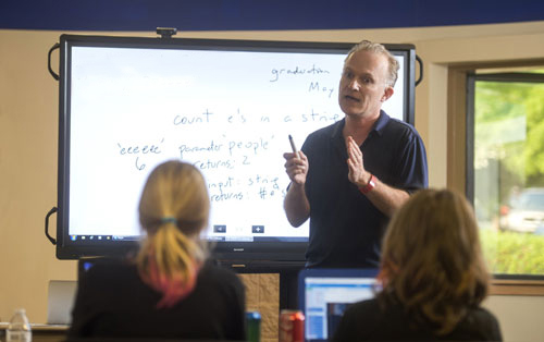 Dr. Johnstone teaching in a classroom.