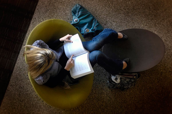 Student reading in a campus study area.