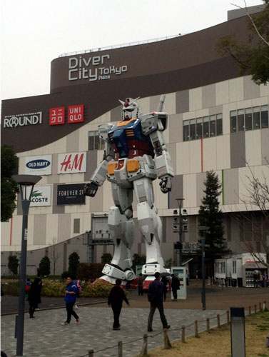 Image of a Tokyo shopping mall with a life size Gundam fighting mecha statue. Image courtesy of George Northen.