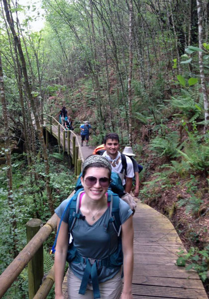 UAB Spanish students hiking through a forest.