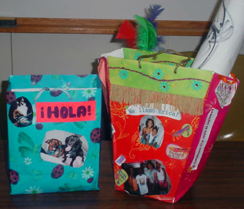 Two la bolsa projects, colorful bags with images and words pasted on them, decorated in festive colors.