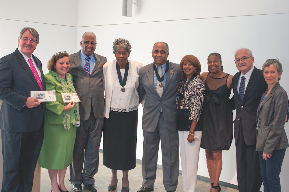 Dean Palazzo, AEIVA Director Lisa Tamiris Becker, Renee Kemp-Rotan and the Honorable Mayor William A. Bell of the City of Birmingham stand with foot soldiers who marched in Selma on Bloody Sunday as well as representatives of Peter Magubane and Spider Martin, including Martin's daughter Tracy.
