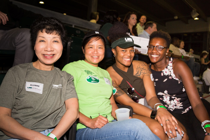 Four women attending the Alumni night.