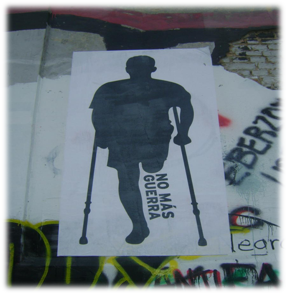 "Poster of a man missing a leg on crutches; ""no mas guerra"" written in place of missing leg."