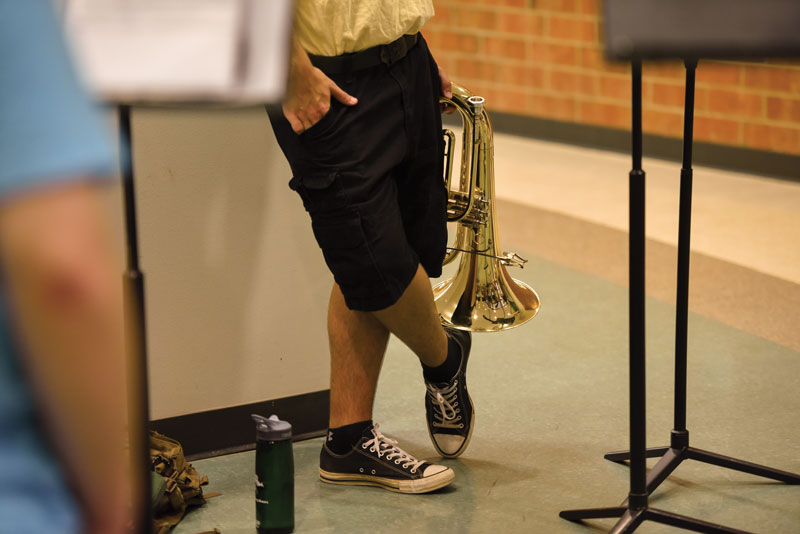 Student holding his baritone horn at band camp.