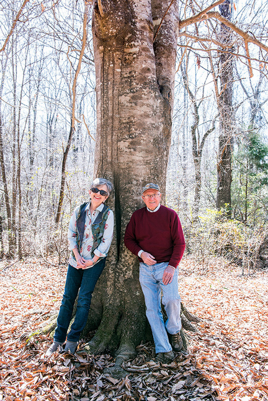 Jane and Jim Ed Mulkin on a walk in the woods.