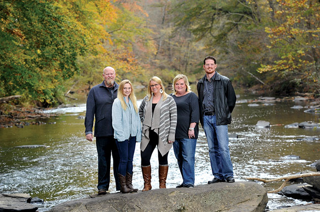 UAB graphic design professor Doug Barrett with students Jennifer Waycaster, Samantha Gibbons, Amy Clark, and Daniel Twieg at the Cahaba River.