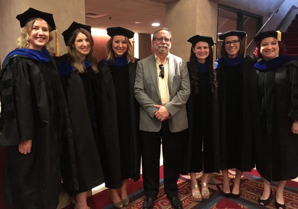 Dr. Ed Cook and students at graduation.