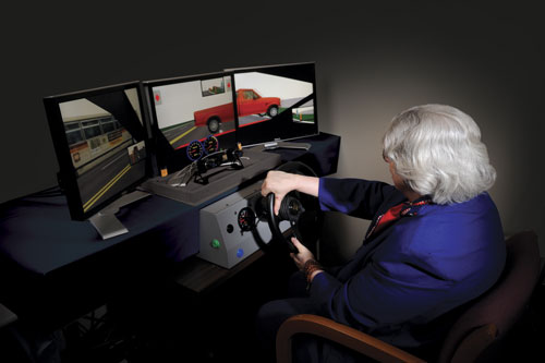 An elderly test subject using a driving simulator.
