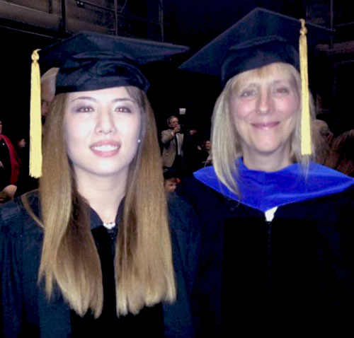 New PhD Lee Anne Flahh and alumni/professor Julie Locher.