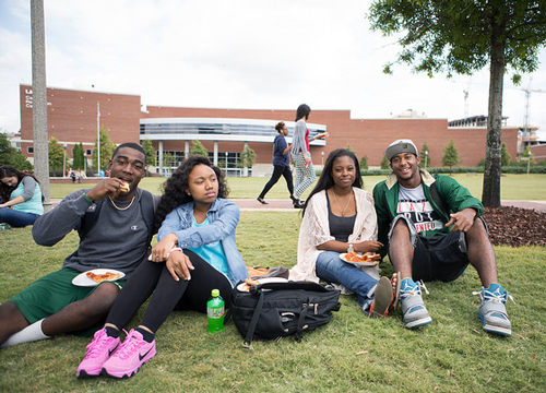 Male and female African American students on the UAB Campus Green.