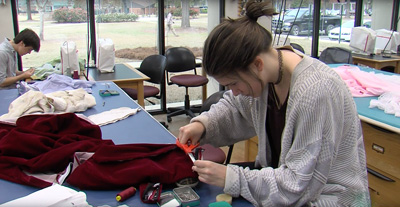 Student working with fabric in UAB Costume Studio