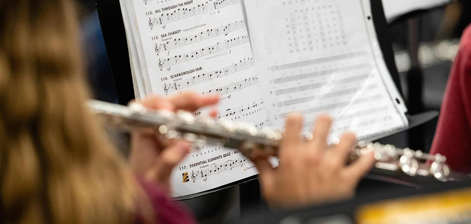 Photo of student playing flute
