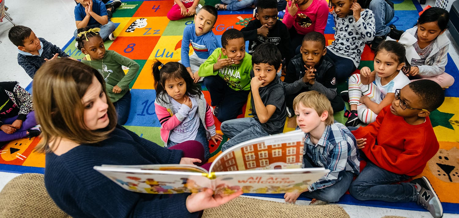 Photo of teacher reading to her class