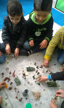 Students with Toy Army Figures