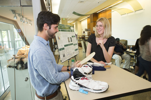 Student demonstrates his design and evaluation of a Shoe-Sock Interface to be used in a Post-Stroke Gait Training Application.