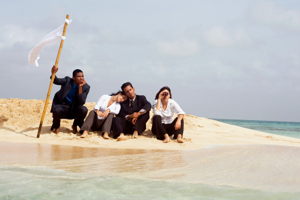 Four graduate students on sitting on a deserted island.