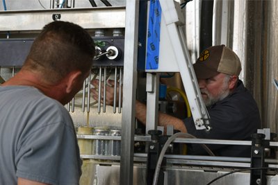 DeBoer working in his brewery with staff.