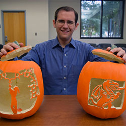 Michael Schultz with pumpkin carvings.