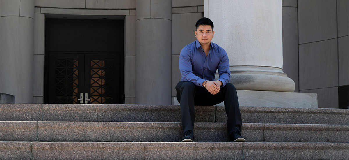 Samir Rana sitting on the steps of the Shelby Biomedical Research Building.
