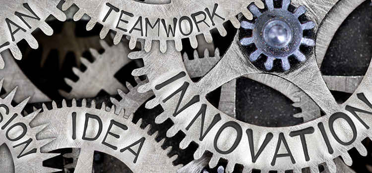 Vision, ideas, and teamwork gears turning innovation gear.