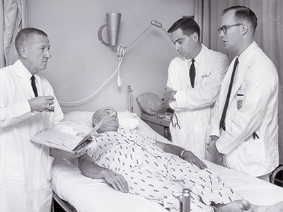 Dr. Frommeyer with residents James Barrett and Crawford Owen, Jr.