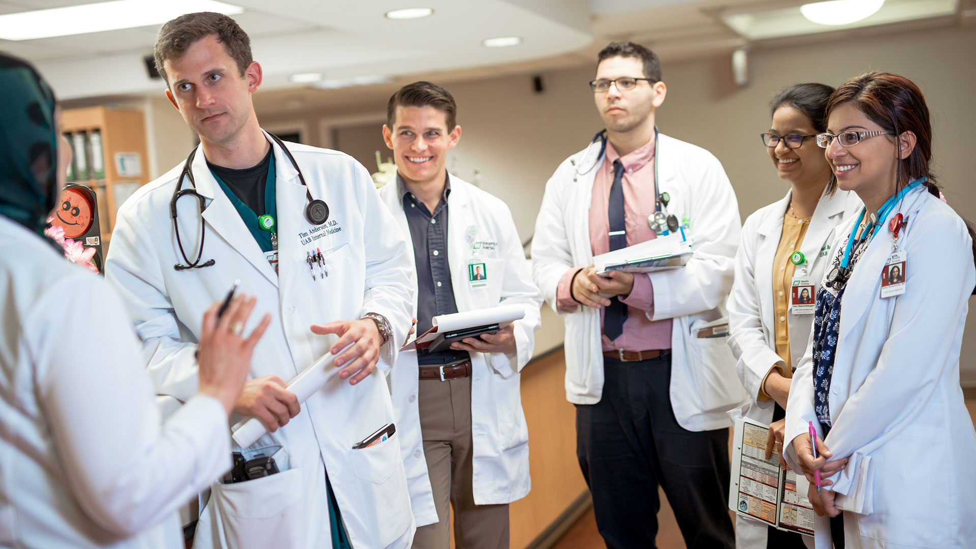students and doctor talking