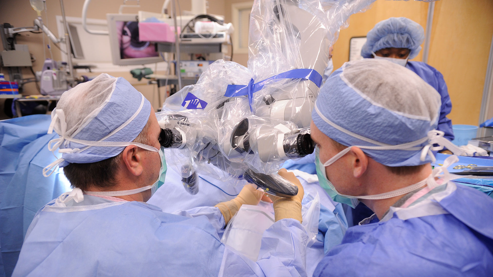 medical residents performing procedure