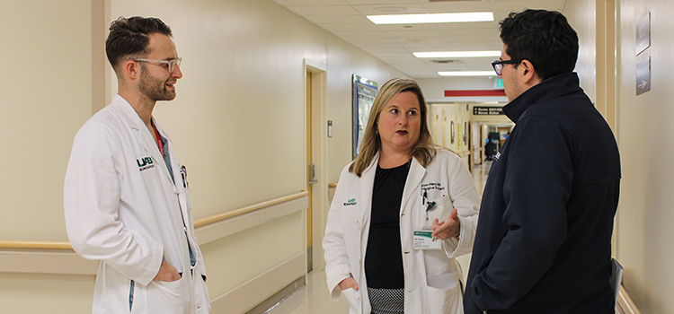 Dr. Kristen Riley talks with residents at their regular neuro-vascular conference at UAB Hospital.