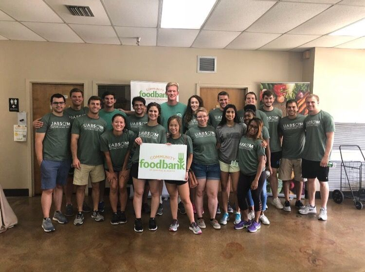 Barfield-Carter LC volunteering at the Community Foodbank of Central Alabama