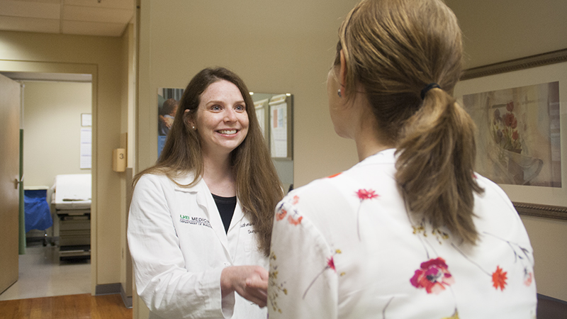 The Division of Surgical Oncology's Dr. Catherine Parker speaks with a patient at the UAB Breast Health Clinic.