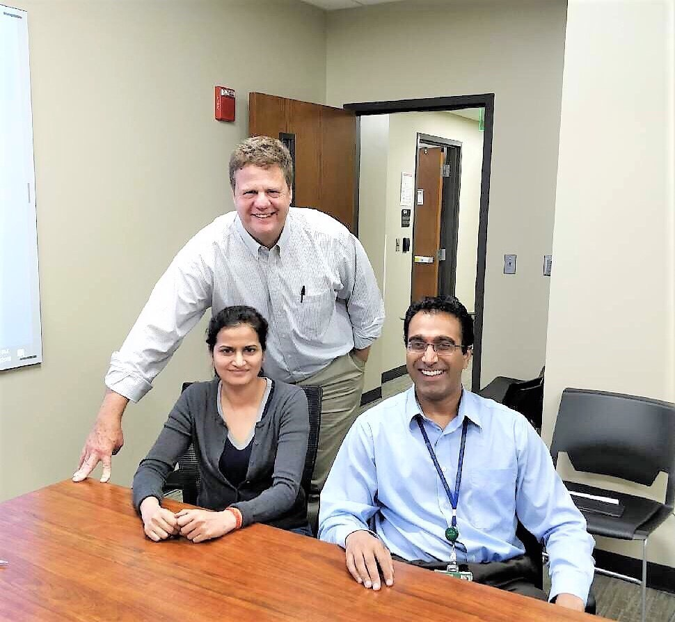Clockwise from top left: Dr. James Bibb, Dr. Sushanth Reddy and Dr. Priyanka Gupta are researching two rare kinds of neuroendocrine tumors using precision medicine.