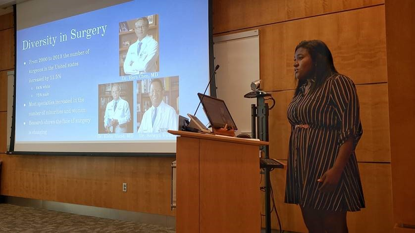 "Alabama School of Fine Arts and UAB PRISM student Oluwatosin Badewa presents her research, ""A Novel Application of Artificial Intelligence to Assess Diversity in Surgical Performance,"" at the PRISM and SURE presentation reception in Wallace Tumor Institute on July 24. (Photo by Rebecca Turner)"