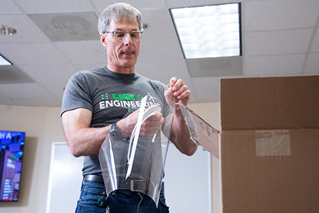 Tim Wick, UAB Engineering, putting together a prototype face shield