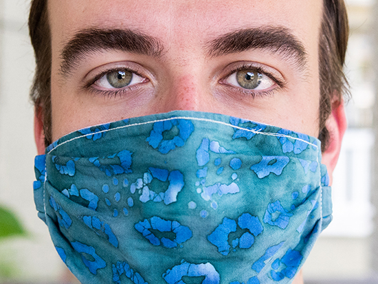 Close-up of Jordan Lingo (Graduate Student, Microbiology) wearing a homemade fabric mask while standing outdoors during the COVID-19 (Coronavirus Disease) pandemic, April 2020.