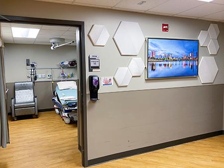 Hospital hallway with art of Birmingham skyline