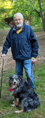 Patrick Jones standing with dog.