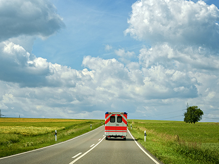 Ambulance driving on a rural Highway