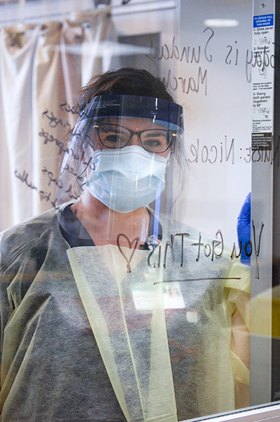 Female nurse is wearing Personal Protective Equipment (PPE) while working in the Hospital during the COVID-19 (Novel Coronavirus) pandemic, March 2020.