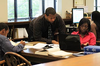 Students compare data at the Birmingham Public Library