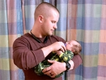 Father unites with baby in NICU for first time after deployment